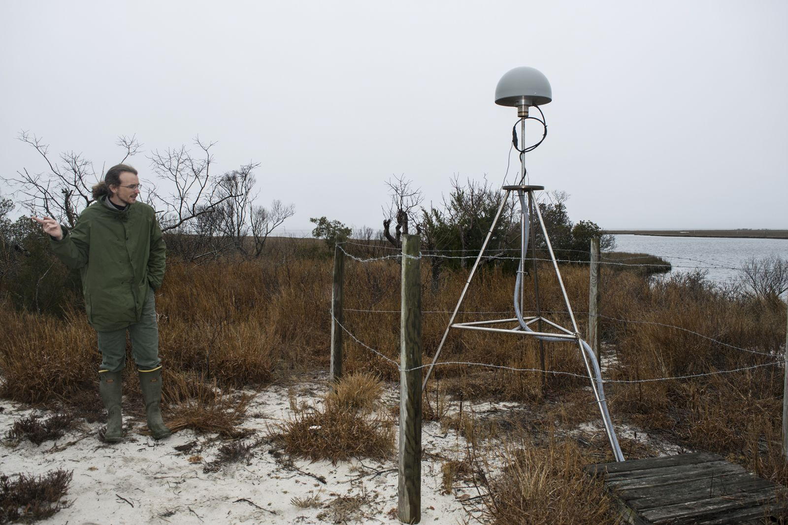 GIS specialist, Neil Winn, next to core station in Assateague, Maryland