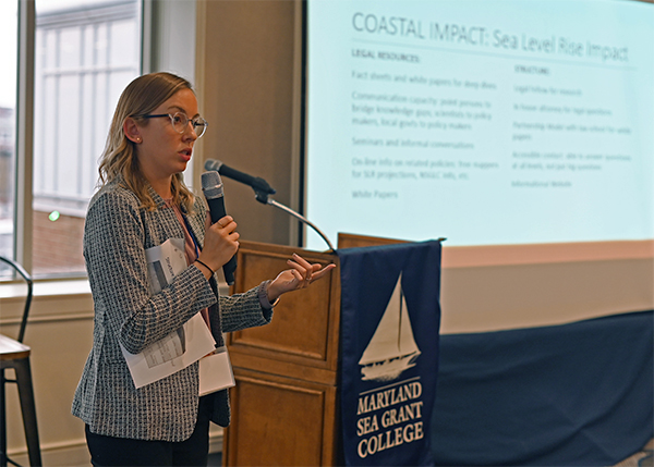 Eva May reports out on her group's ideas on sea level rise impacts at the close of the roundtable meeting.