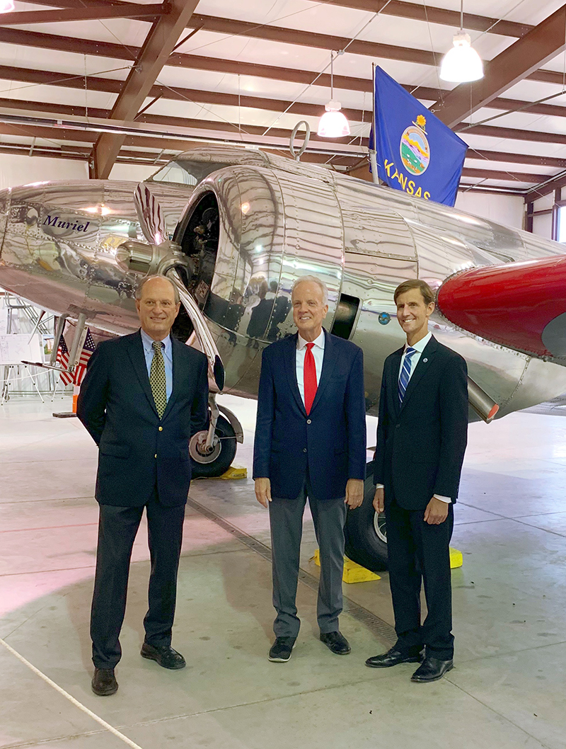 Dr. Bob Ballard, U.S. Senator Jerry Moran, and Admiral Timothy Gallaudet (from left) standing in front of Muriel.