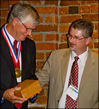 eugene burreson receives medal from troy hartley