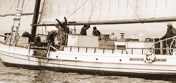 watermen on oyster dredgeboat under sail