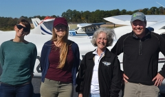Cora Johnston, Julia Rentsch, Mary MacMutcheon, and Scott Lerberg in front of airplane