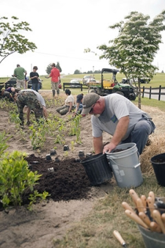 cecil county watershed steward academy participants install a rain garden near Fair Hills Maryland to soak of stormwater runoff