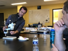 J. Adam Frederick reviews microscopic techniques with teachers at South Carroll High School.